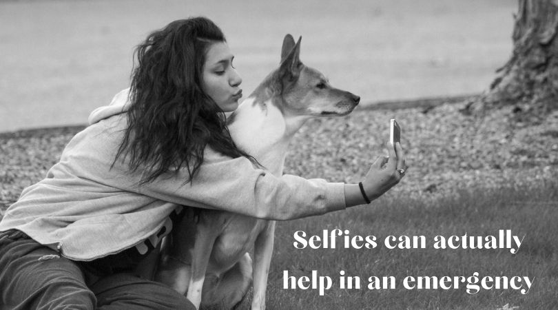 Woman taking a selfie with her dog